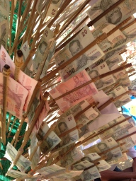 Individual Thai Baht notes make up the leaves of the money tree.